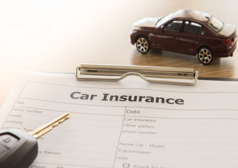 Car insurance form with car keys